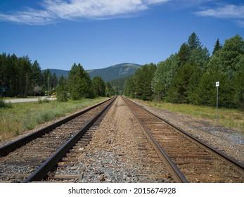 Railroad track passing through field, Cranbrook, British Columbia, Canada - Shutterstock ID 2015674928