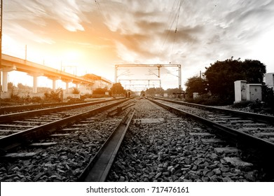 Railroad track at the time of sunset.
