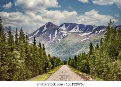 Railroad track in the wilderness of Alaska