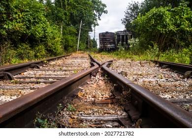 Railroad Tracks with abandoned train cars