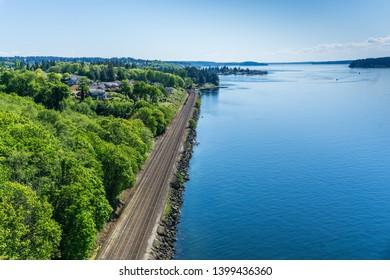 Railroad tracks along the shore of the Tacoma Narrows waterway.