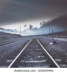 Railroad tracks with dark moody background and colors