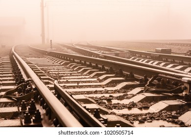 Railroad tracks in a fog on autumn