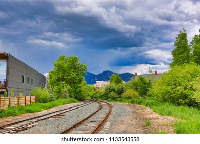 Railroad tracks go through Bozeman, Montana and lead into the rocky Mountains.  Trains are popular for travel in this area and add to the quaint nature of this town.