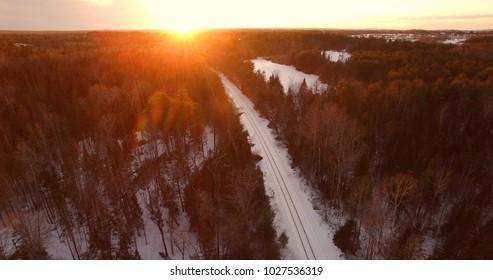 Railroad tracks leading to sunset