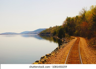 Railroad tracks seen from the back of an Adirondack train heading to Montreal, Canada, from New York, USA.