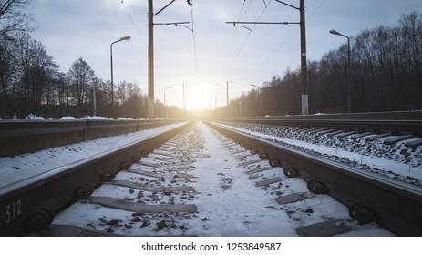 Railroad tracks in the setting sun vintage toned