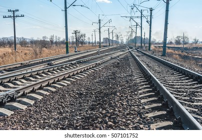 Railroad tracks stretching into the distance beyond the horizon