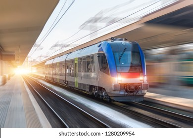 Railroad travel passenger train with motion blur effect, industrial concept, tourism