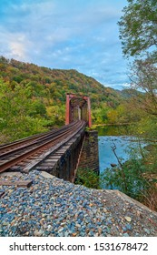 Railroad trestle with fall colors and the New River, WV.
