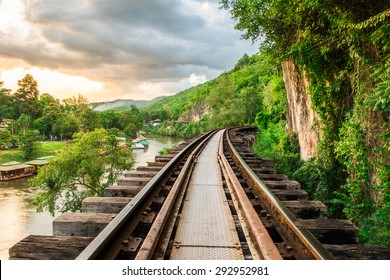 Railroad wood history world war II in river kwai at evening sunset, kanchanaburi, thailand