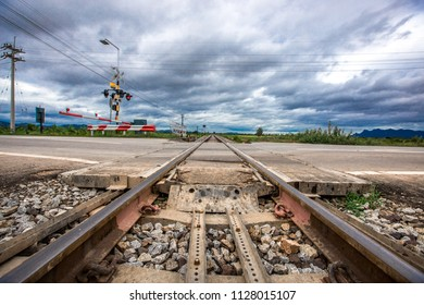 Railroads at intersections often have obstructions or traffic lights to prevent accidents while trains run.