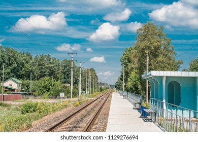 rails on trainstation with nature background