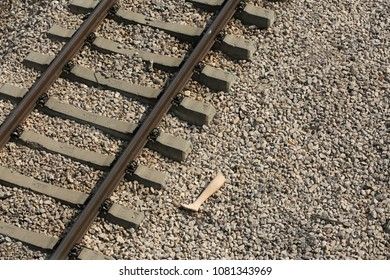 Rails for the train and the torn leg of the dummy