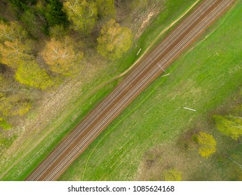 Railway aerial drone view. Railway in green field from above.