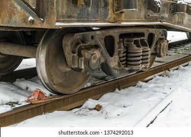 Railway brake shoe under the train wheel on the rails