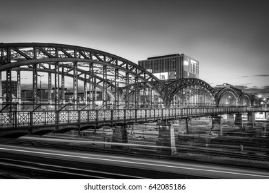 Railway Bridge in black and white with long exposure of trains under the bride (place of taken is Hackerbruecke (Hackerbrucke) in Munich, Germany)