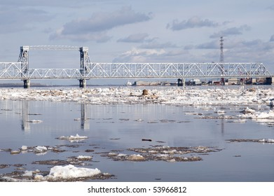 Railway bridge by springtime.Driving of ice goes On river