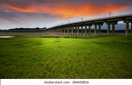 Railway Bridge, a large reservoir, but the water became greener pastures, scenes landscape thailand.