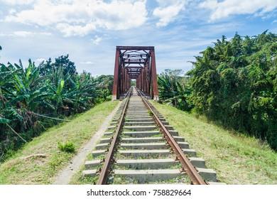Railway bridge over Ay river in Valle de los Ingenios valley near Trinidad, Cuba