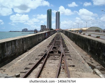 The railway bridge over the Capibaribe river with the twin towers in the background, in Recife, Brazil.