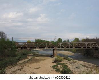 Railway bridge over River Malone in Brandizzo, Italy