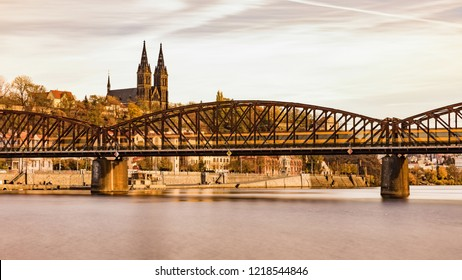 Railway Bridge over the Vltava River, Vysehrad in the background. A sunny day at the Vltava river in Prague