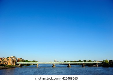 Railway bridge in Putney with blue sky background in London, England, UK