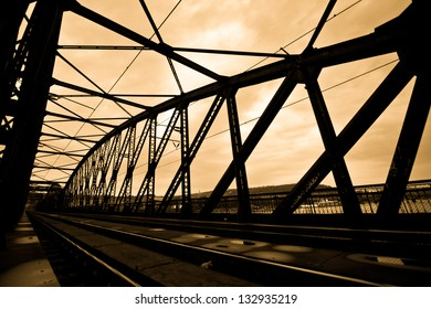 Railway bridge silhouette in Prague in the sunset