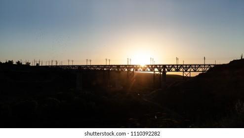 railway bridge structure at sunset