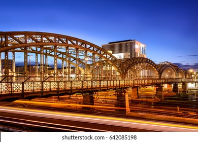 Railway Bridge at twilight with long exposure of trains under the bride (place of taken is Hackerbruecke (Hackerbrucke) in Munich, Germany)