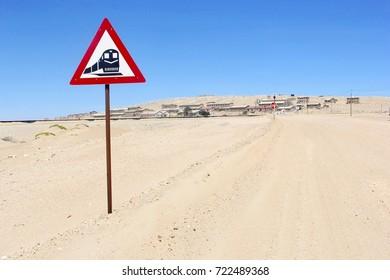 Railway crossing and panoramic view at vintage ghost town Kolmanskop (Kolmannskuppe) in Namib Naukluft desert, Namibia, Africa