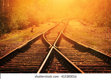 Railway crossroad in the evening sun.