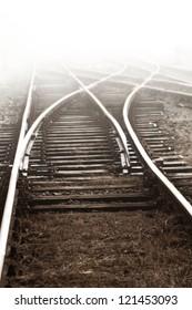 Railway in fog on station, outdoor landscape