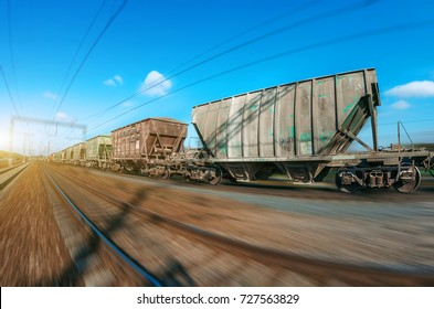 The railway hopper car for the transportation rail road train in motion at speed