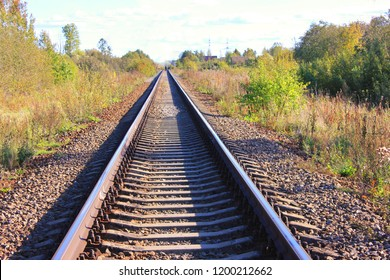 Railway Industrial Landscape with Train Track Sleepers, Close Up Autumn Day View. Railroad Commuter Transportation Industrial and Train Travel Concept, Perspective View