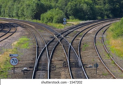 A railway junction with lines curving to left and right. No trains.