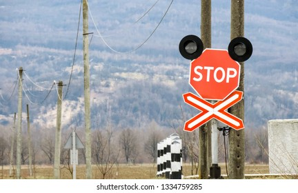 Railway level crossing with a saltire and a stop sign Saint Andrew's Cross
