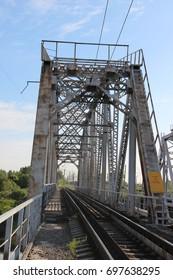 Railway metal bridge perspective view. Steel rail track. Black and white image