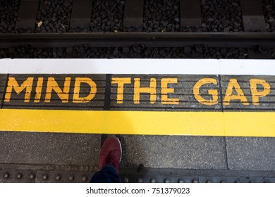 Railway and mind the gap sign