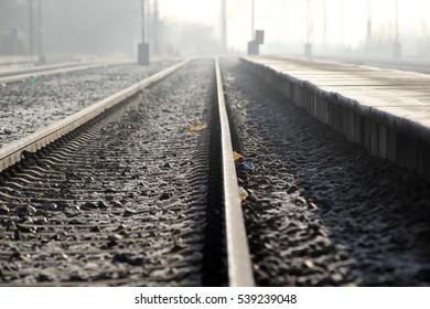 railway on foggy winter day in Nova Pazova, Serbia