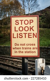 A railway pedestrian crossing sign warning at an old station in Goathland, England.