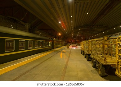 The railway platform and the train at night.