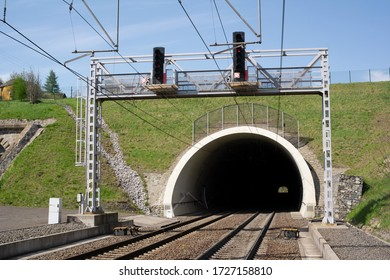 Railway and railroad track is goint into dark and long tunnel. Infrastructure building and underground passageway.