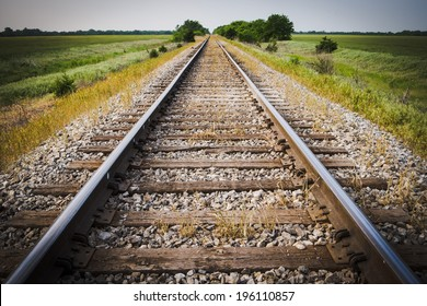Railway, Railroad, Train Tracks, With Green Pasture Early Morning