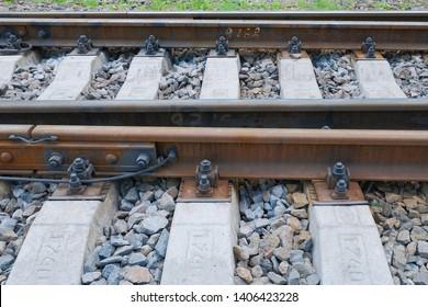 Railway rails on concrete sleepers.