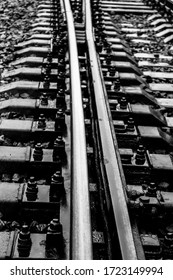 Railway, rails in the rain in black and white.