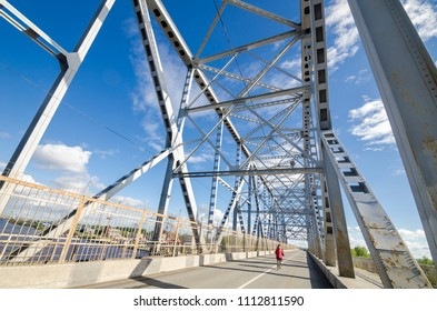 Railway, road and pedestrian bridge across the river Severnaya Dvina. Russia, Arkhangelsk