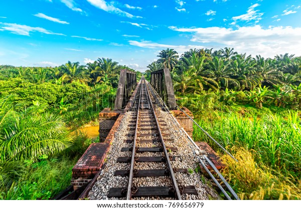 Railway from Singapore to Bangkok in the jungle of  Malaysia.