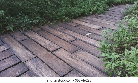 Railway sleepers are used as a landscape material on garden footpath. It is a matter of reusing resources. They are durable and have an earthly color which blends well with the natural environment.